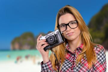 Female photographer holding a vintage camera
