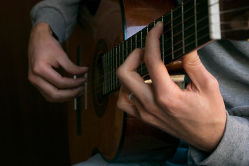 classic acustig guitar player performing, focus on hands