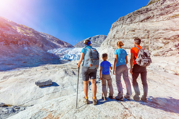 Family with two kids hiking in mountains, active travel