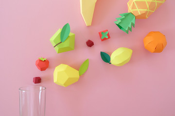 exotic fruits made of paper on pink background