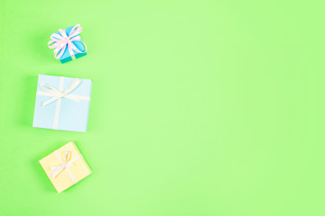 Festive, birthday, Gift pastel minimal background. Multicolored Gift boxes on green background. Wedding, elegant, Love, birthday romance concept