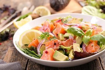Wall Mural - vegetable salad with salmon and basil