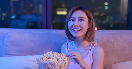 woman watch movie with popcorn