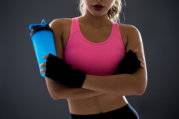 woman with protein shake bottle