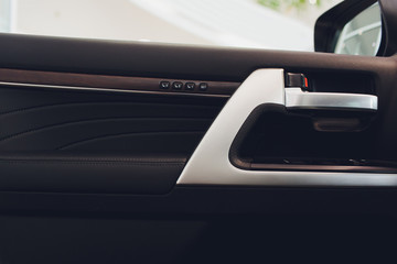closeup of car door handle,car interior. plating