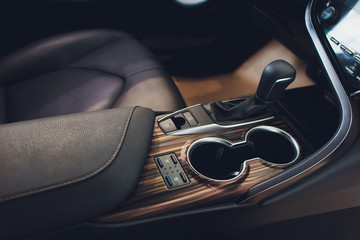 Close up view of a gear lever shift. Manual gearbox. Car interior details. Car transmission. Soft lighting. Abstract view.
