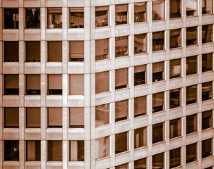 Abstract developed image of an office high-rise with almost square windows