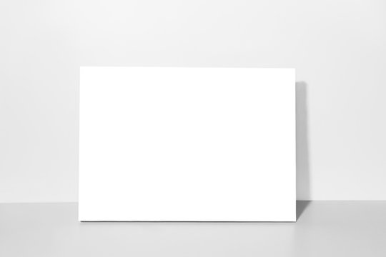 Blank canvas, gray wall on background. Mockup poster frame.