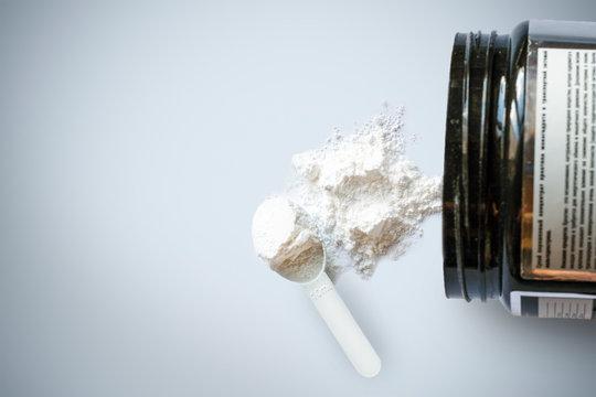 Sport supplement, creatine, hmb, bcaa, amino acid or vitamin mesure with powder. Sport nutrition concept. bcaa, l-carnitine, creatine