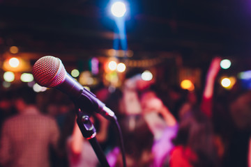 microphone against blur on beverage in pub and restaurant background. Wall mural