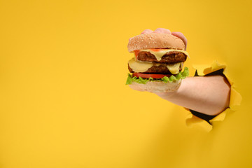 Fototapeta Hand taking a big burger obraz