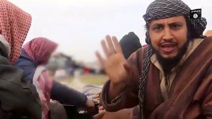 A man said to be an Islamic State militant, Abu Abd Al-Azeem, speaks in Baghouz