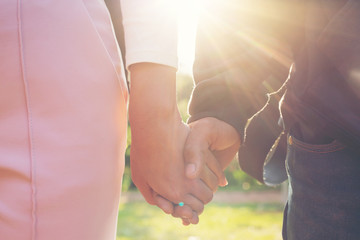 Couples holding hands.Summer in love.