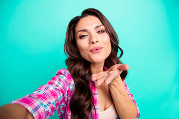 Close up photo amazing beautiful she her lady make take selfies pretty wish happy holidays instagram followers wearing casual plaid checkered pink shirt outfit isolated teal bright vivid background