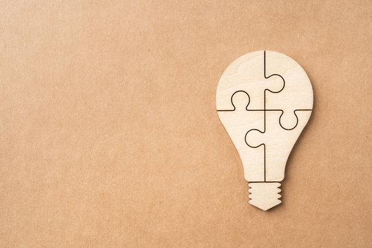 light bulb jigsaw icon with idea concept