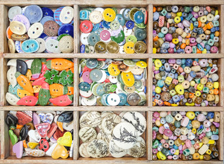 Multi-colored buttons for clothes in a box.