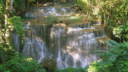 Wall Mural - Waterfall flow standing with forest enviroment high angle view in thailand called Huay or Huai mae khamin in Kanchanaburi Provience, Thailand., Lockdown.