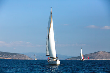 Wall Mural - Sailing yacht boats at the Aegean Sea - Greece. Luxury cruise yachting.