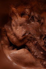Chocolate cocoa ice cream brown texture background. Delicious refreshing creamy summer dessert
