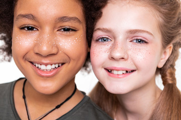 Pleasant good-looking kids displaying their strong white teeth