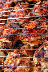 Grilled chicken leg snack for outdoor party. Meat on fire.