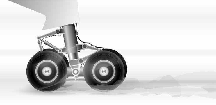 The chassis of the modern aircraft when landing on the runway. Wheels rotate rapidly. Smoke comes from braking.
