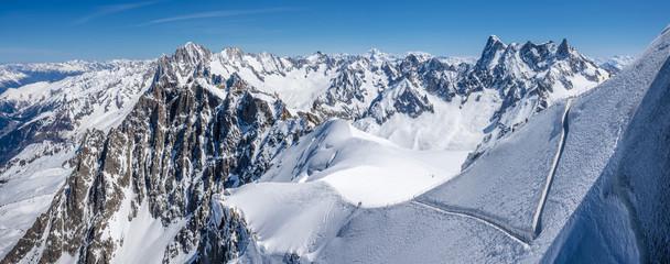 Mont-Blanc Mountain Range, Chamonix, Hautes-Savoie, Alps, France: Winter View from Aiguille du Midi near the Vallee Blanche ski resort, Les Grandes Jorasses (right) and Chamonix Needle (left)