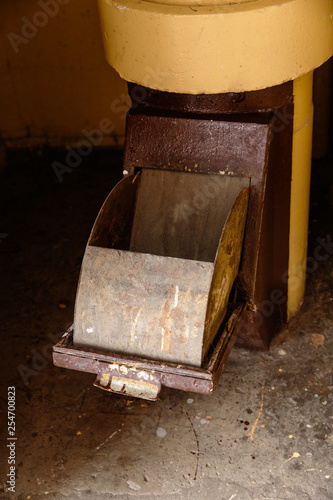 Old garbage chute in apartment building with cheap