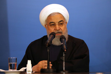 Iranian President Hassan Rouhani speaks during a meeting with tribal leaders in Kerbala