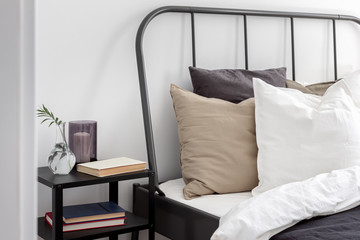 Bed with metal headboard