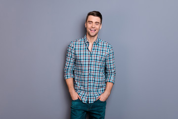 Close up photo attractive amazing he him his man arms hands in pockets ideal perfect hairdo styling easy-going wearing casual plaid checkered shirt jeans denim outfit isolated grey background