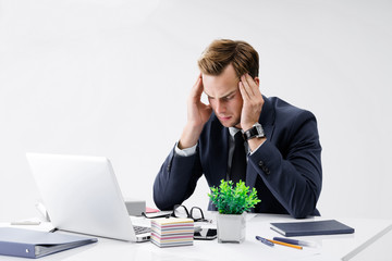 Stressed businessman at office