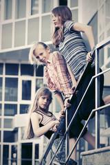 Group of happy school girls on steps