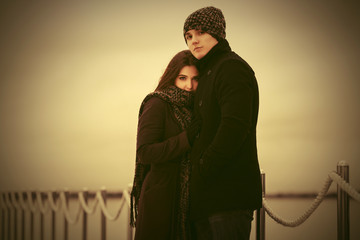 Happy young couple in love embracing outdoor
