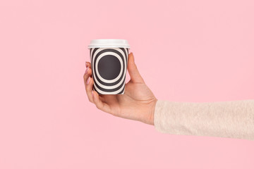 Female hand showing takeout cup