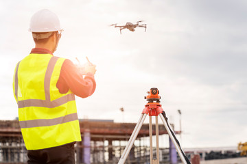 Engineer  working at construction Site with Drone over construction site. Wall mural