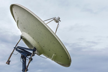 High technology and modern satellite dish on cloudy sky day background