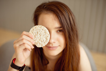 Athletic girl holding crunchy rice cakes, healthy food, healthy lifestyle