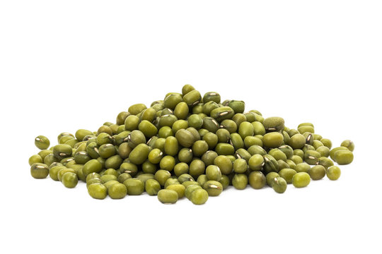 Pile of green mung beans seen from the side and isolated on white background