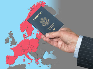 Senior man holding US passport on map of Schengen Zone of European Union in preparation for ETIAS visa
