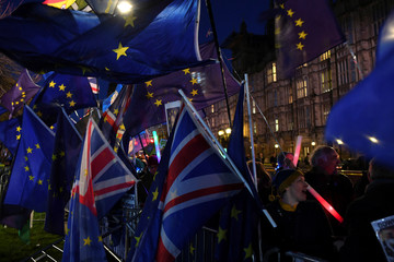 Anti-Brexit supporters gather outside the Parliament in London