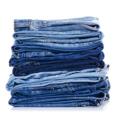 Stack blue jeans on white background isolation
