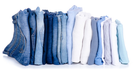 Stack blue jeans and clothes on white background isolation