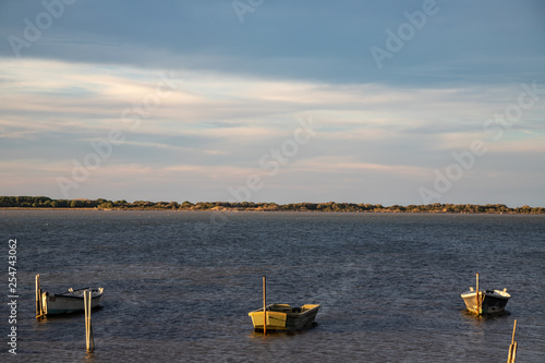 6ce3e7504c three boats on the lake of Lesina at sunset. Gargano National Park, Apulia,