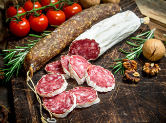 Salami with tomatoes and spices.