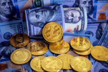 Cryptocurrency Litecoin (LTC) , bitcoin and US dollars on table close up.business concept.