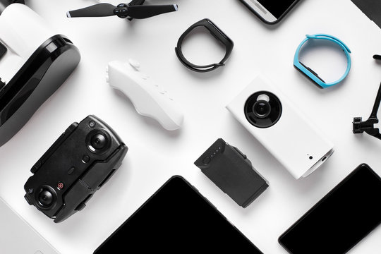 glasses and camera near the smart watch, background image of the gadgets on white surface
