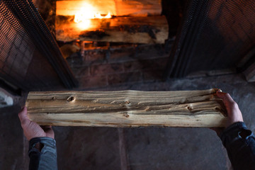 Man holding log for fire
