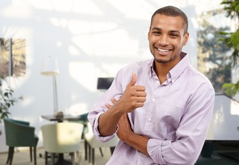 Happy afro-american businessman showing thumb up