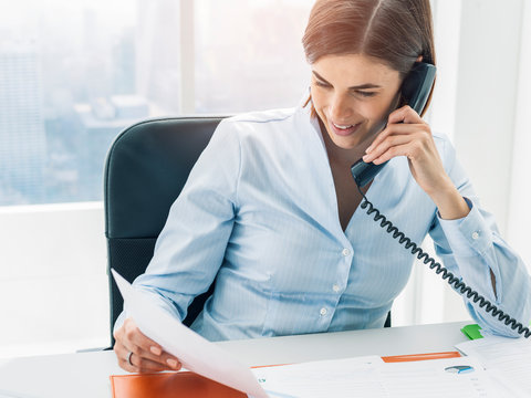 Business executive working in the office and making phone calls